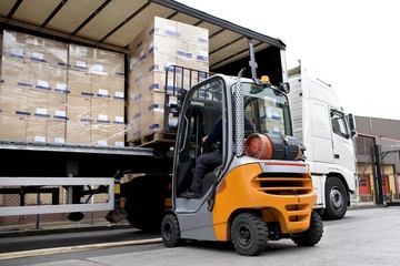 stock-storage-and-logistics-forklift-loading-lorry-pallet-boxes.jpg