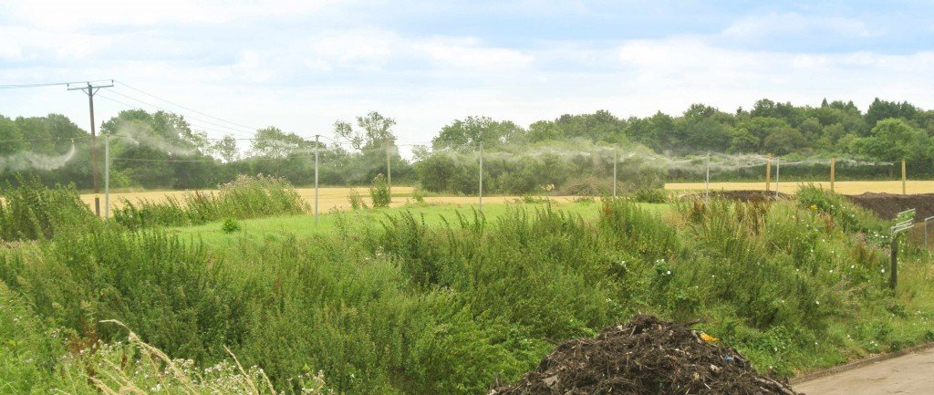 An odour suppression system giving perimeter coverage to a composting site