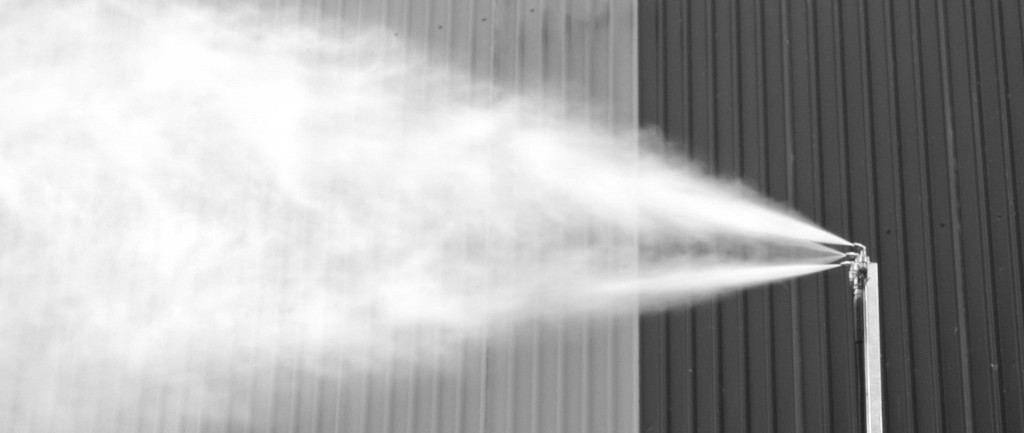 The mist is propelled by water pressure, not a fan, so dust is not stirred up