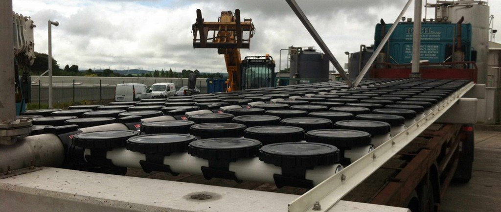 Offloading pre-fabricated modular diffuser systems from a flat-bed truck